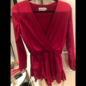 Red long sleeve romper from Lioness with ruffles